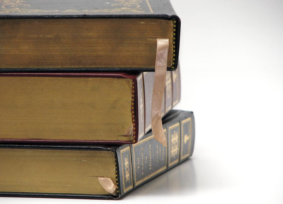 Download Free Stock HD Photo of Close-up of antique books on a white background Online