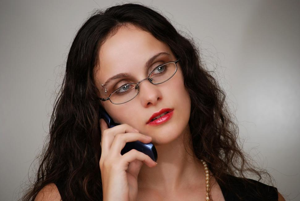 Download Free Stock HD Photo of A beautiful business woman talking on a cell phone Online