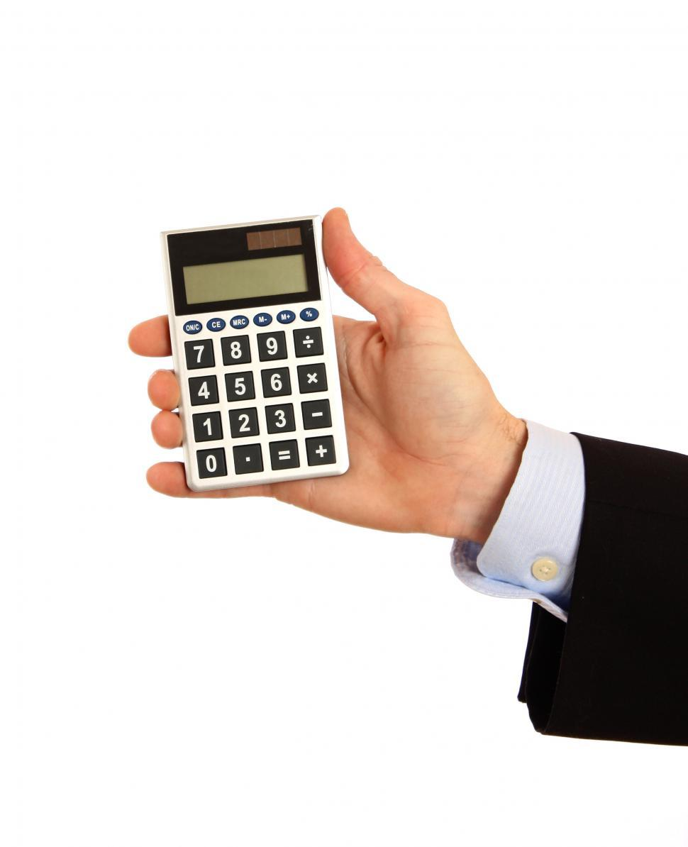 Get Free Stock Photos of A hand holding a calculator Online