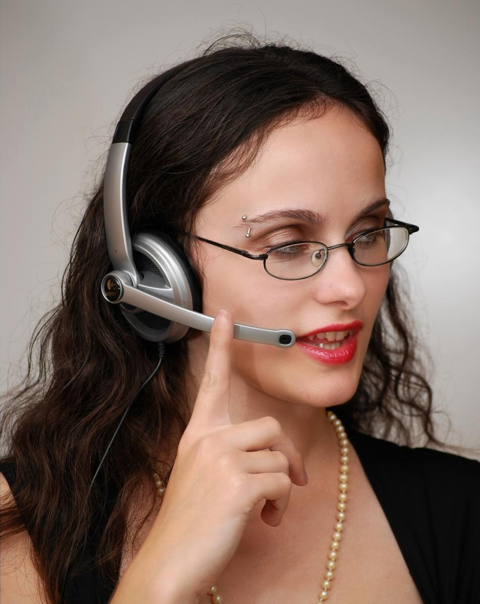 Download Free Stock HD Photo of A beautiful business woman talking on a headset Online