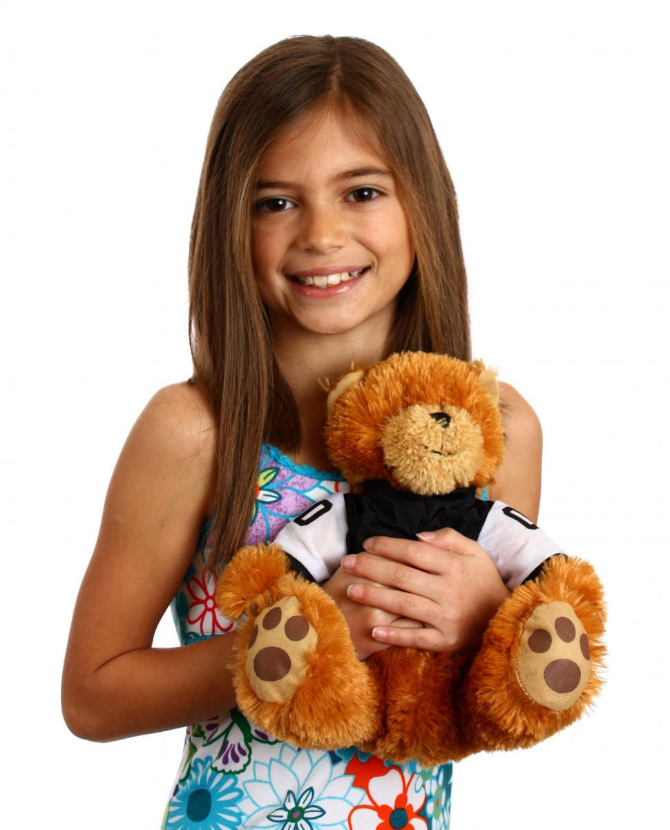 Download Free Stock HD Photo of A pretty young girl holding a teddy bear Online
