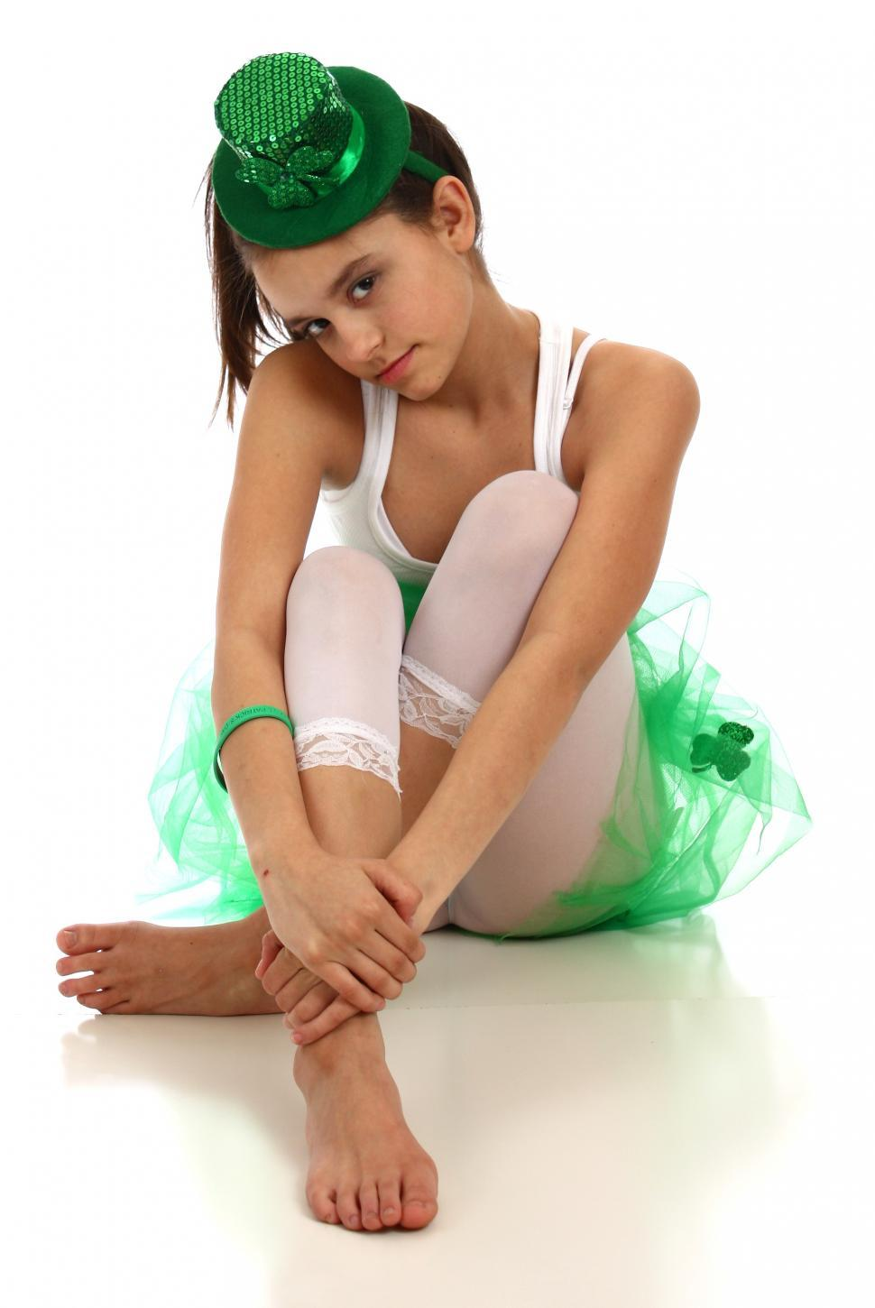 A cute young girl dressed for Saint Patricks Day