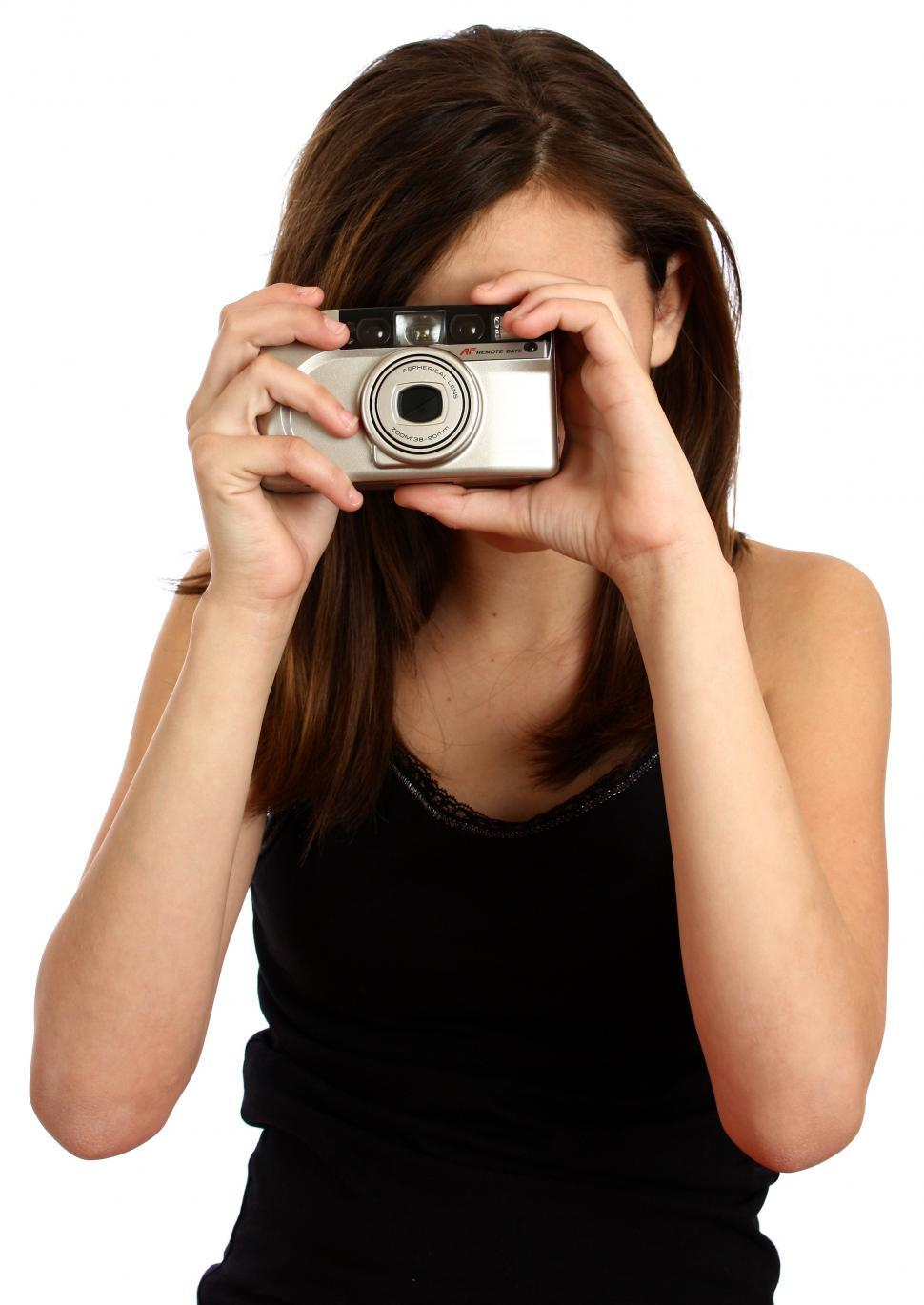 Download Free Stock HD Photo of A cute young girl taking a picture with a camera Online