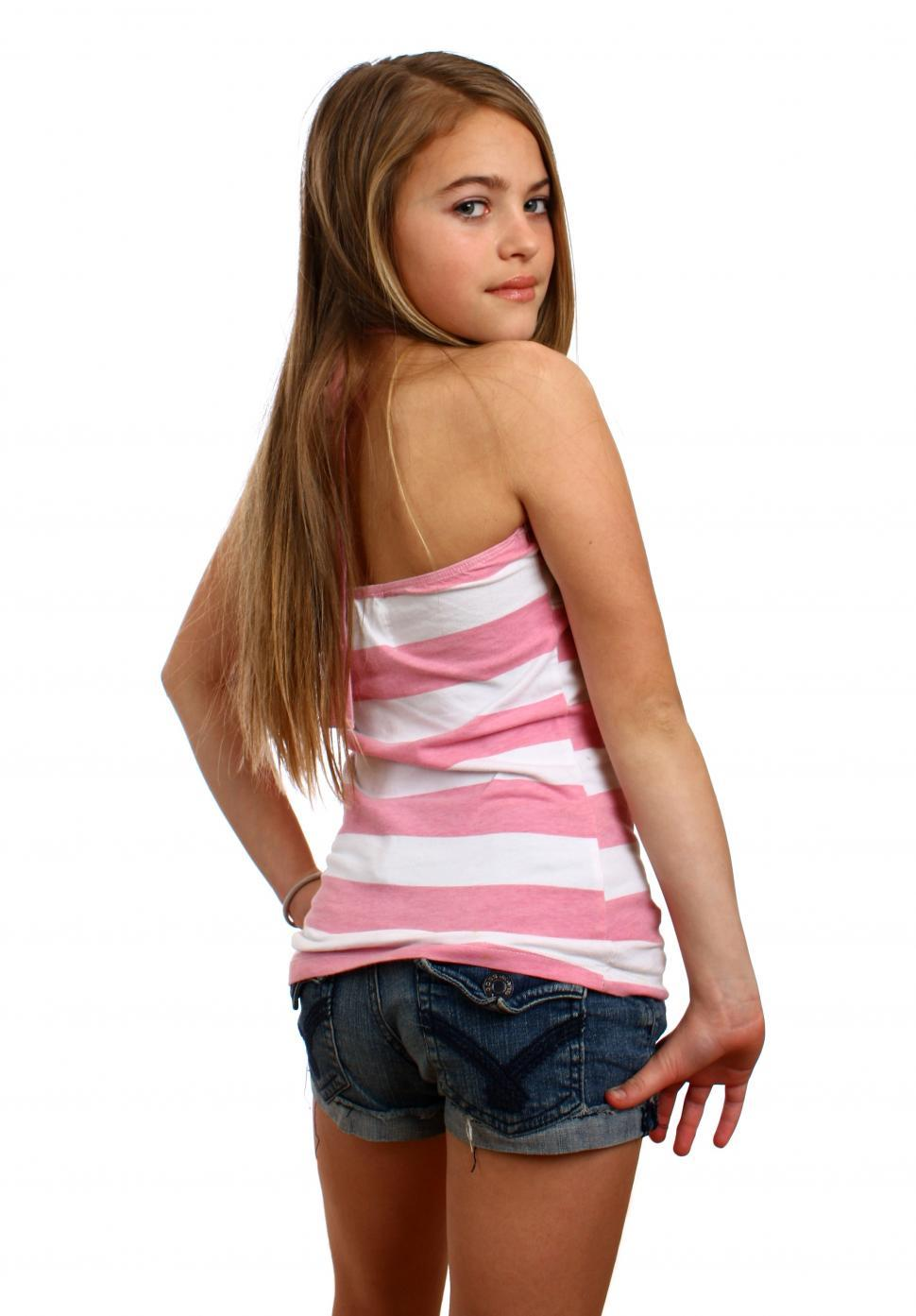 imageDesc for cat A beautiful young girl posing with a white background page People
