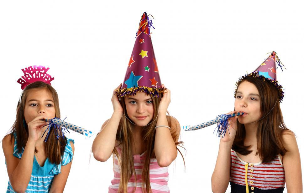 Download Free Stock HD Photo of Three young girls celebrating a birthday Online
