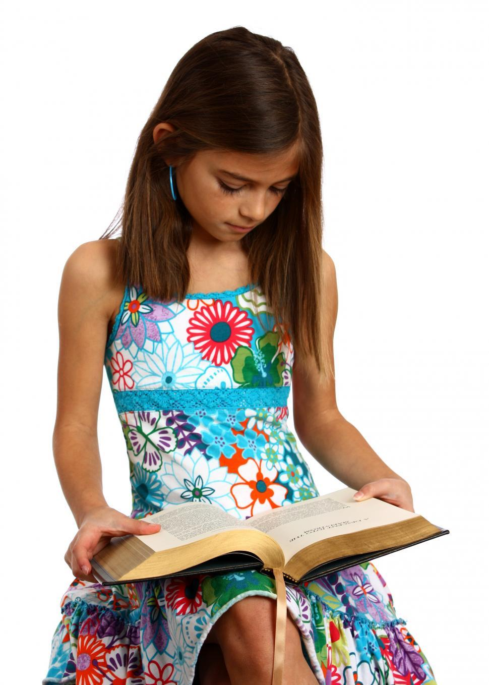 Download Free Stock HD Photo of A pretty young girl reading a book Online