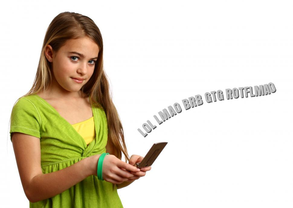 Download Free Stock HD Photo of A beautiful young girl texting on a cell phone Online
