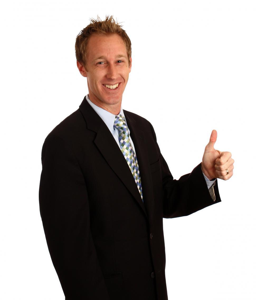 Download Free Stock HD Photo of A young businessman giving a thumbs up signal Online