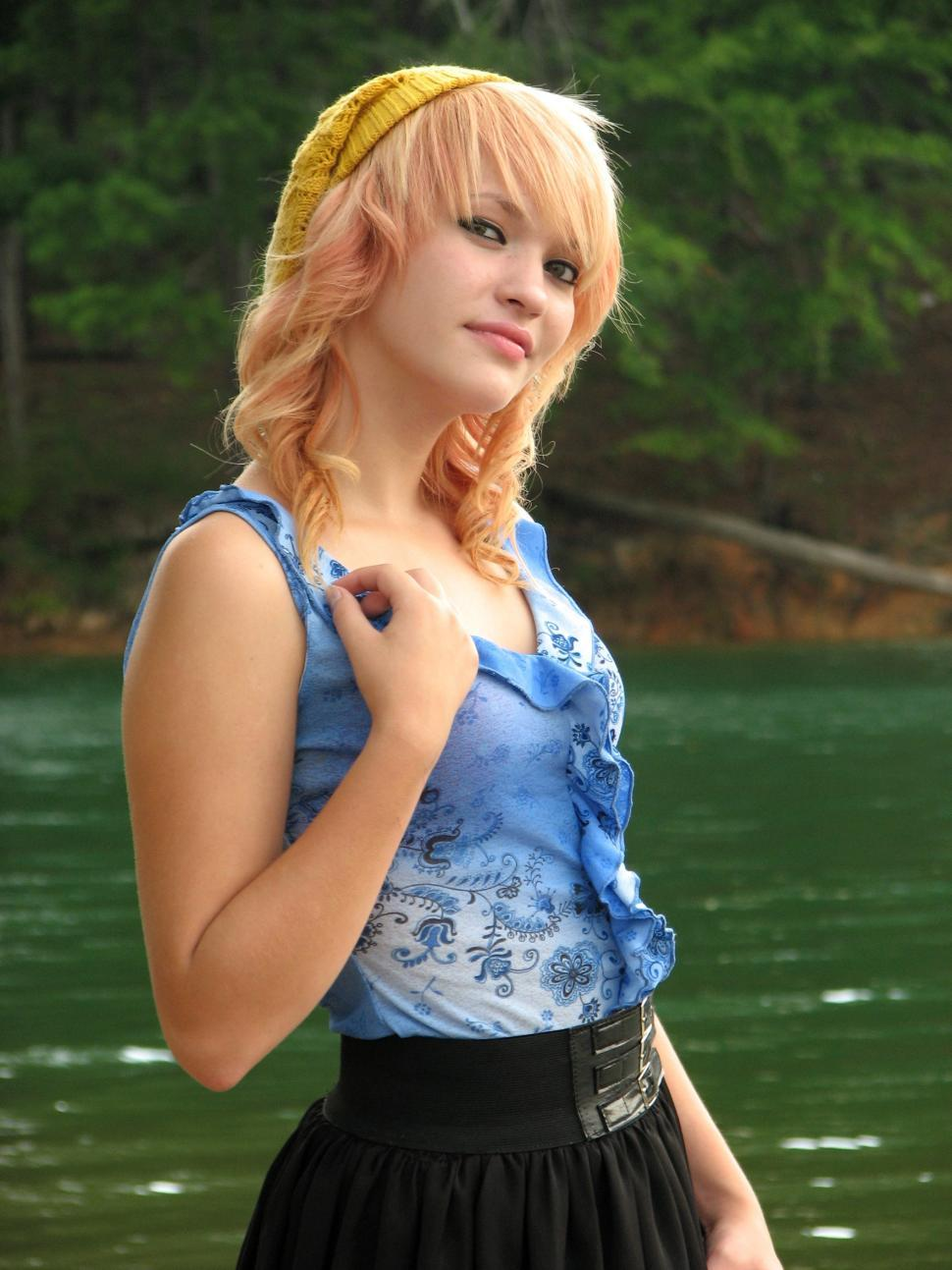 Download Free Stock HD Photo of A beautiful young woman posing by a lake Online