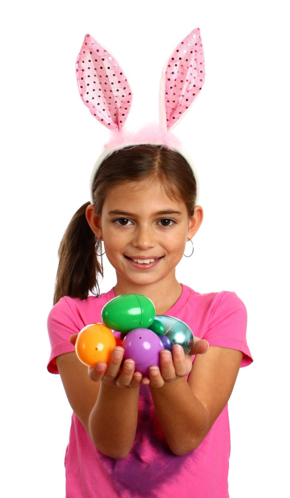 Download Free Stock HD Photo of A cute young girl holding Easter eggs Online