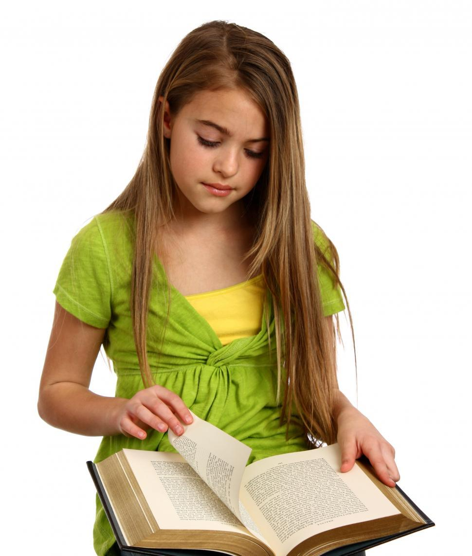 Download Free Stock HD Photo of A beautiful young girl reading a book Online