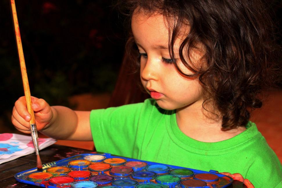 Download Free Stock HD Photo of Child with brush painting with aquarel Online