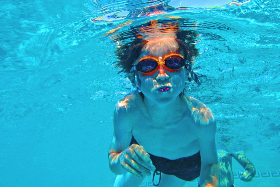 Download Free Stock HD Photo of Child swimming underwater in a swimming pool Online