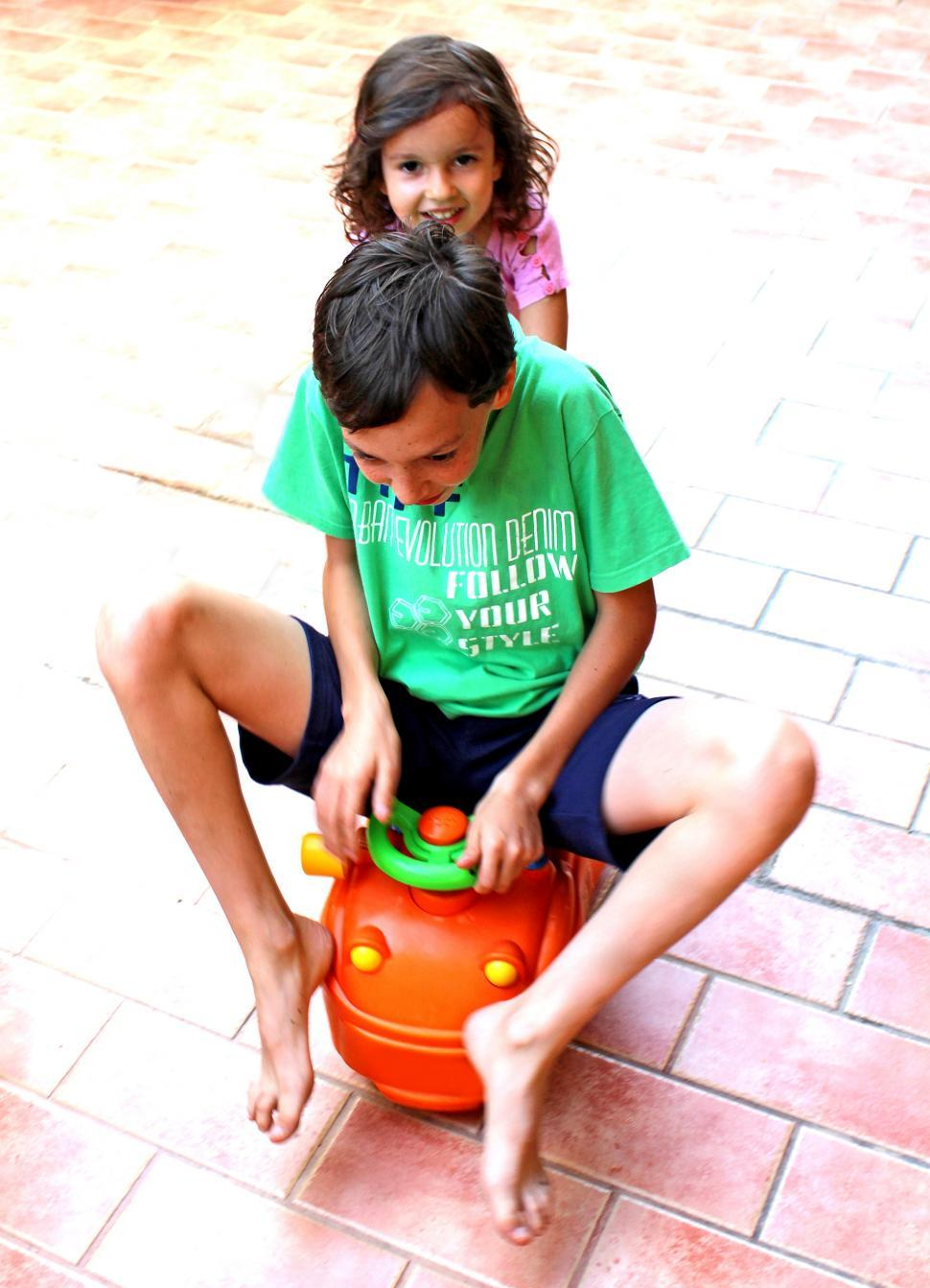 Download Free Stock HD Photo of Happy brothers playing together Online
