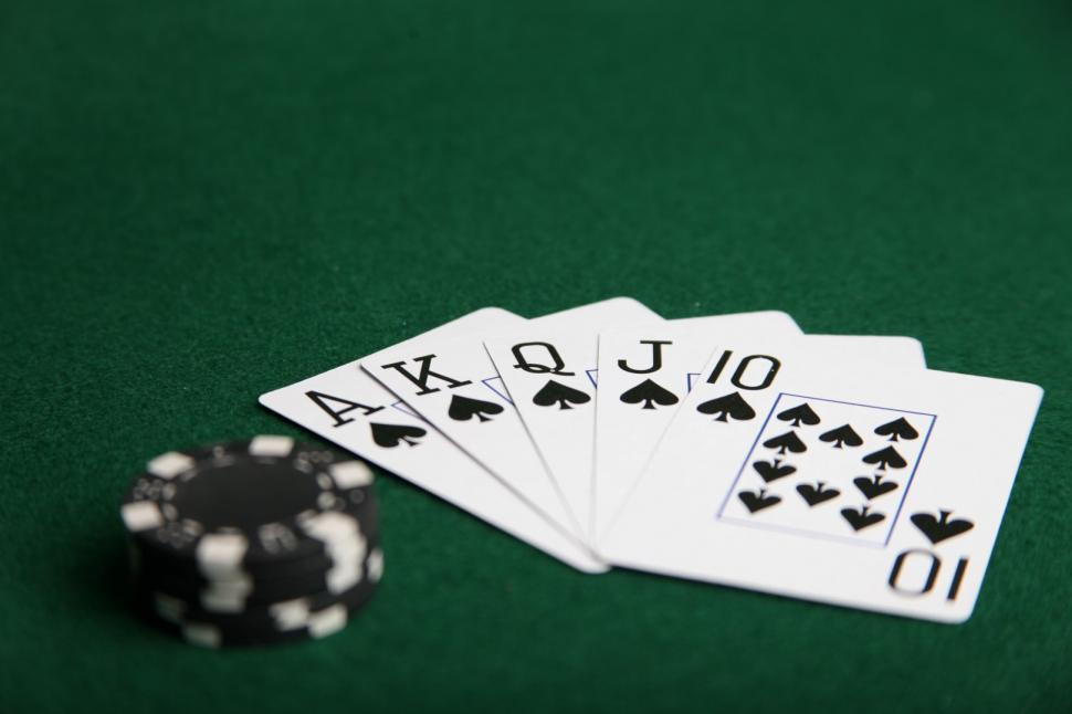 Download Free Stock HD Photo of Royal flush of spades with black poker chips. Online