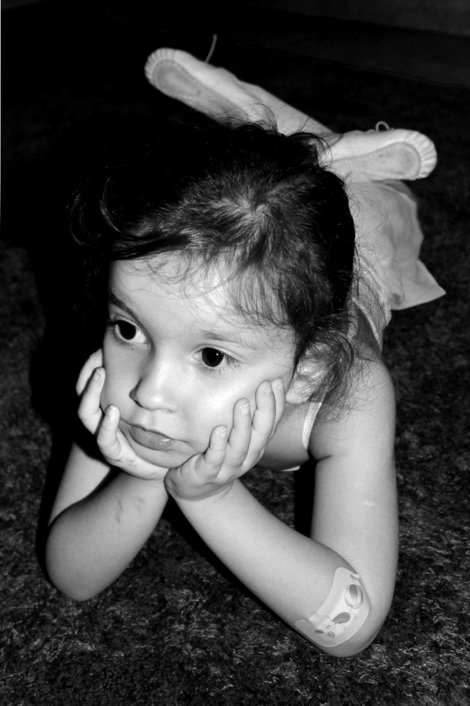 Download Free Stock HD Photo of Thoughtful young ballerina with a band aid on the elbow Online