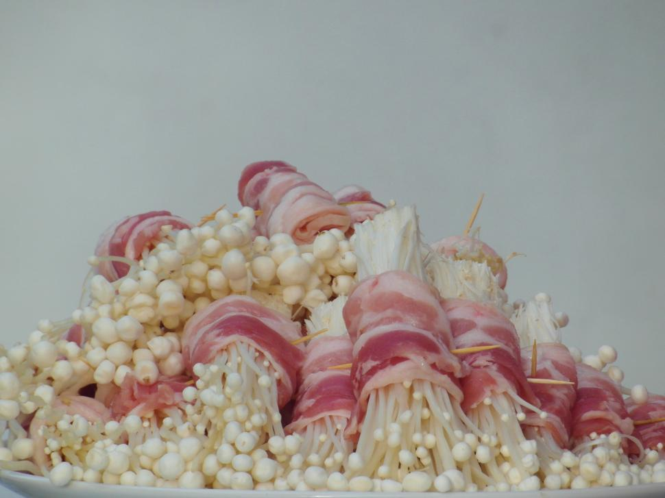 Download Free Stock HD Photo of Enokitake Mushrooms Wrapped in Bacon Online