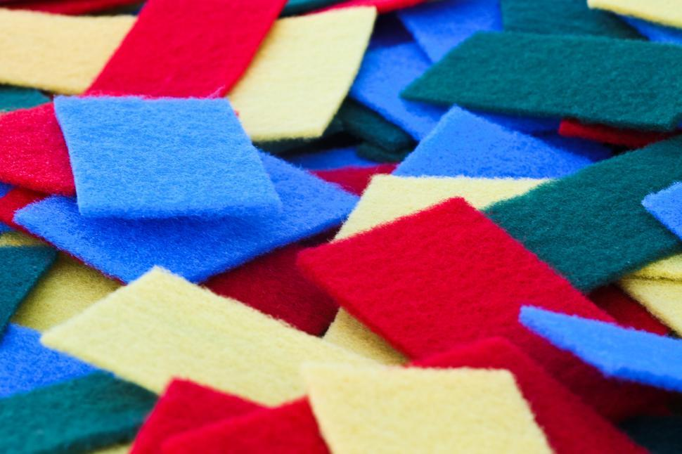 Download Free Stock HD Photo of Colorful pile of scrubbers Online