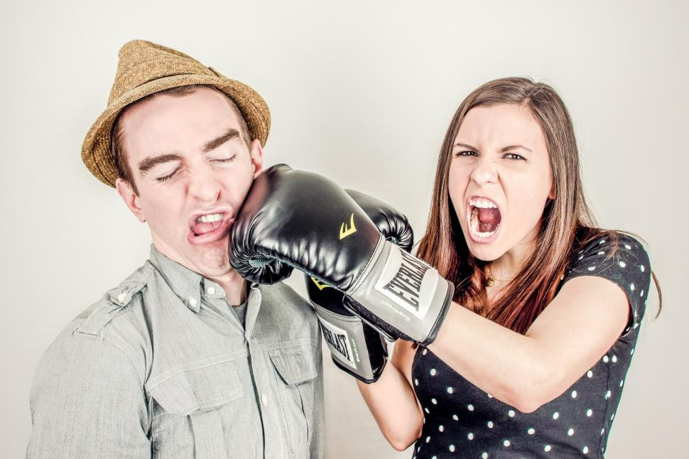Download Free Stock HD Photo of Woman punches a man  Online