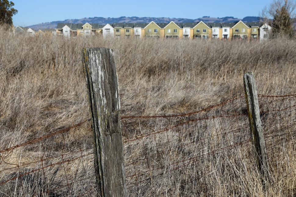 Download Free Stock HD Photo of Dried grass and new construction Online