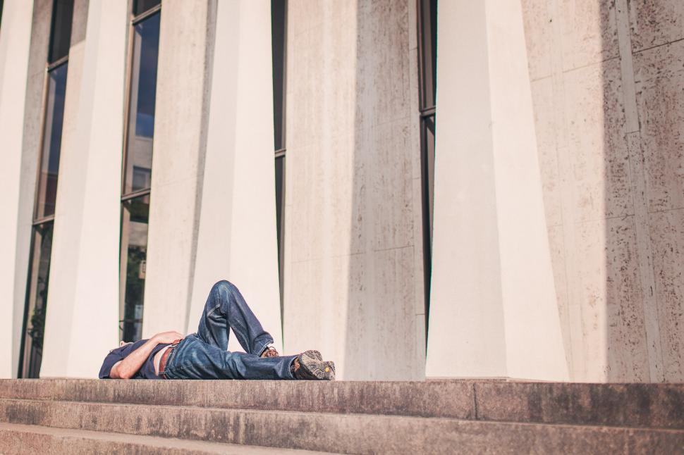 Download Free Stock HD Photo of Young Man lying on his back Online