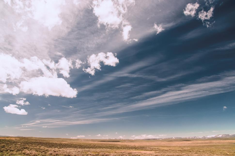 Download Free Stock HD Photo of Clouds over plains Online