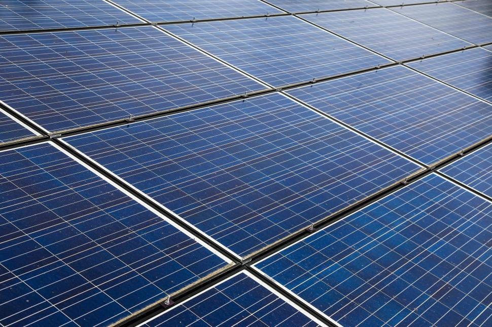 Download Free Stock HD Photo of Solar panels seen in the meadow Online
