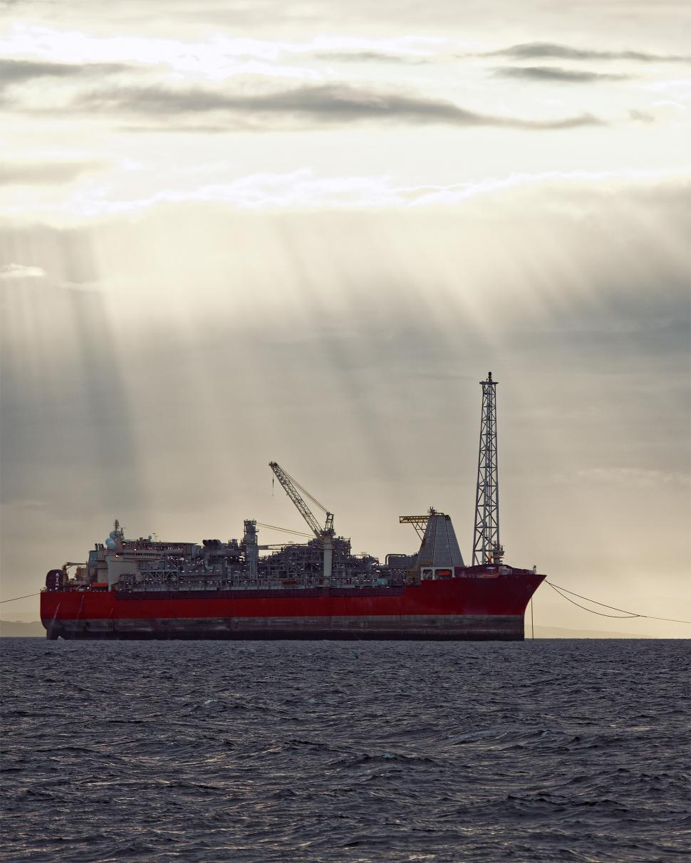 Download Free Stock HD Photo of Oil and gas FPSO at sunset Online