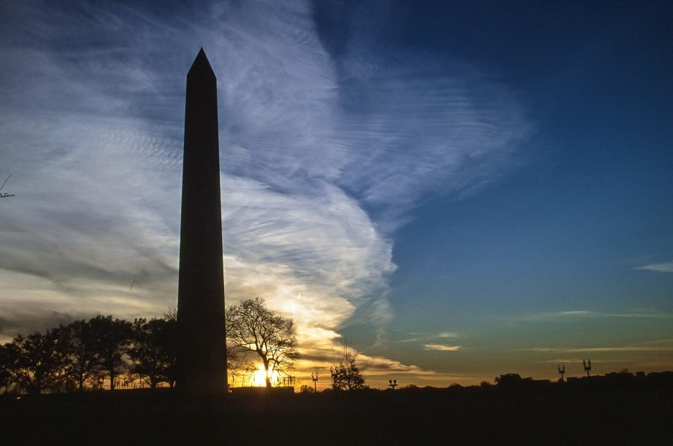 Free image of Sun sets behind the Washington Monument.