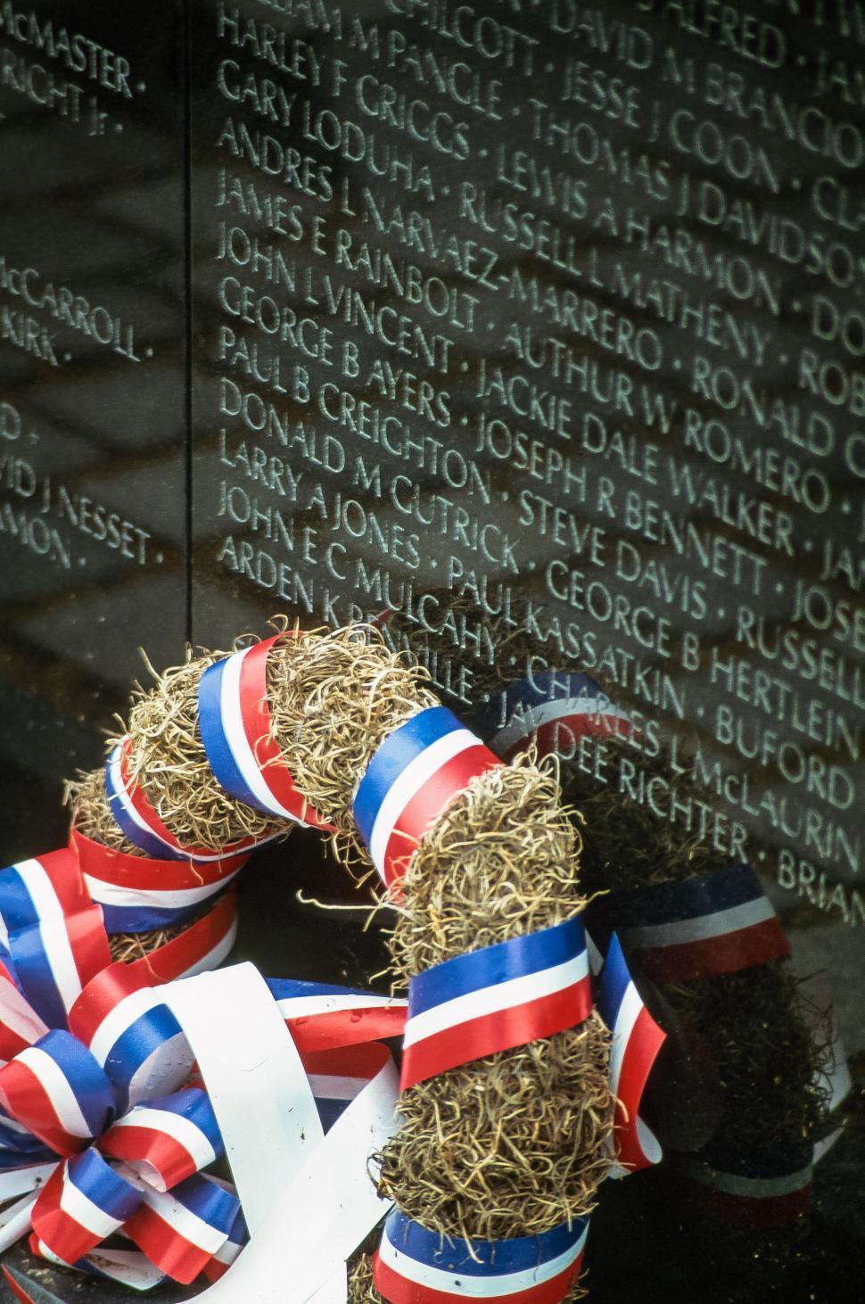 Free image of A weathered wreath at the wall of the Vietnam Memorial.