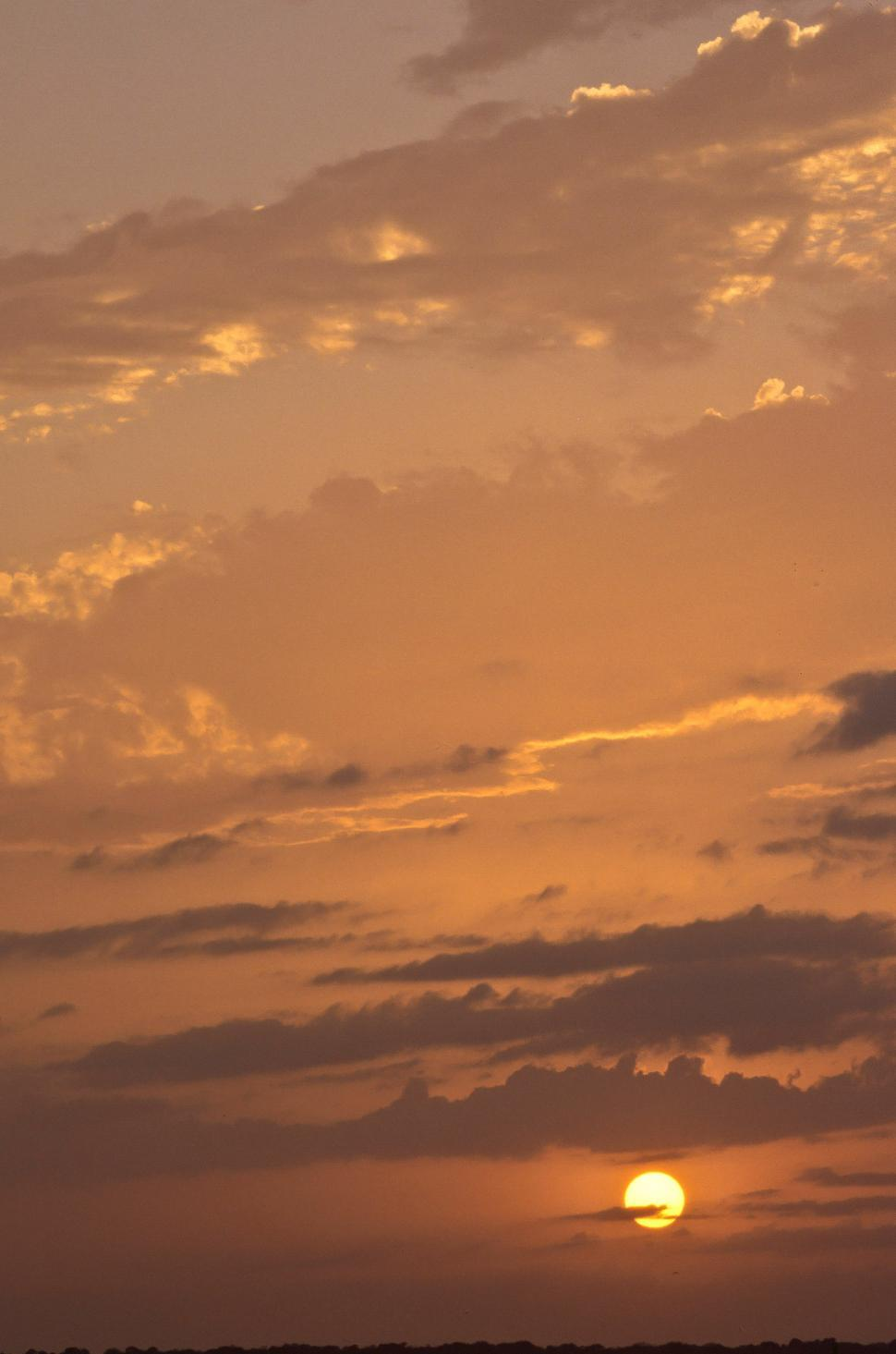 Free image of A cloudy golden sunset sky at Sebastian Inlet.