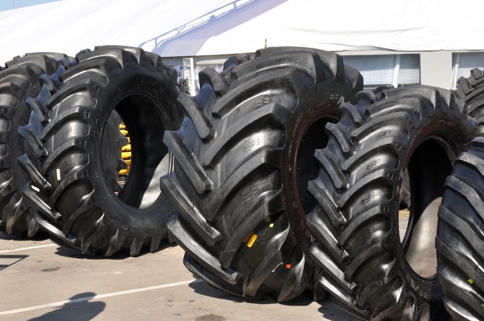 Download Free Stock HD Photo of Row of tractor tyres Online