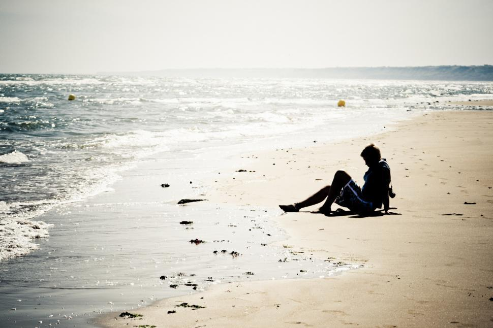Download Free Stock HD Photo of Girl sitting on the beach Online