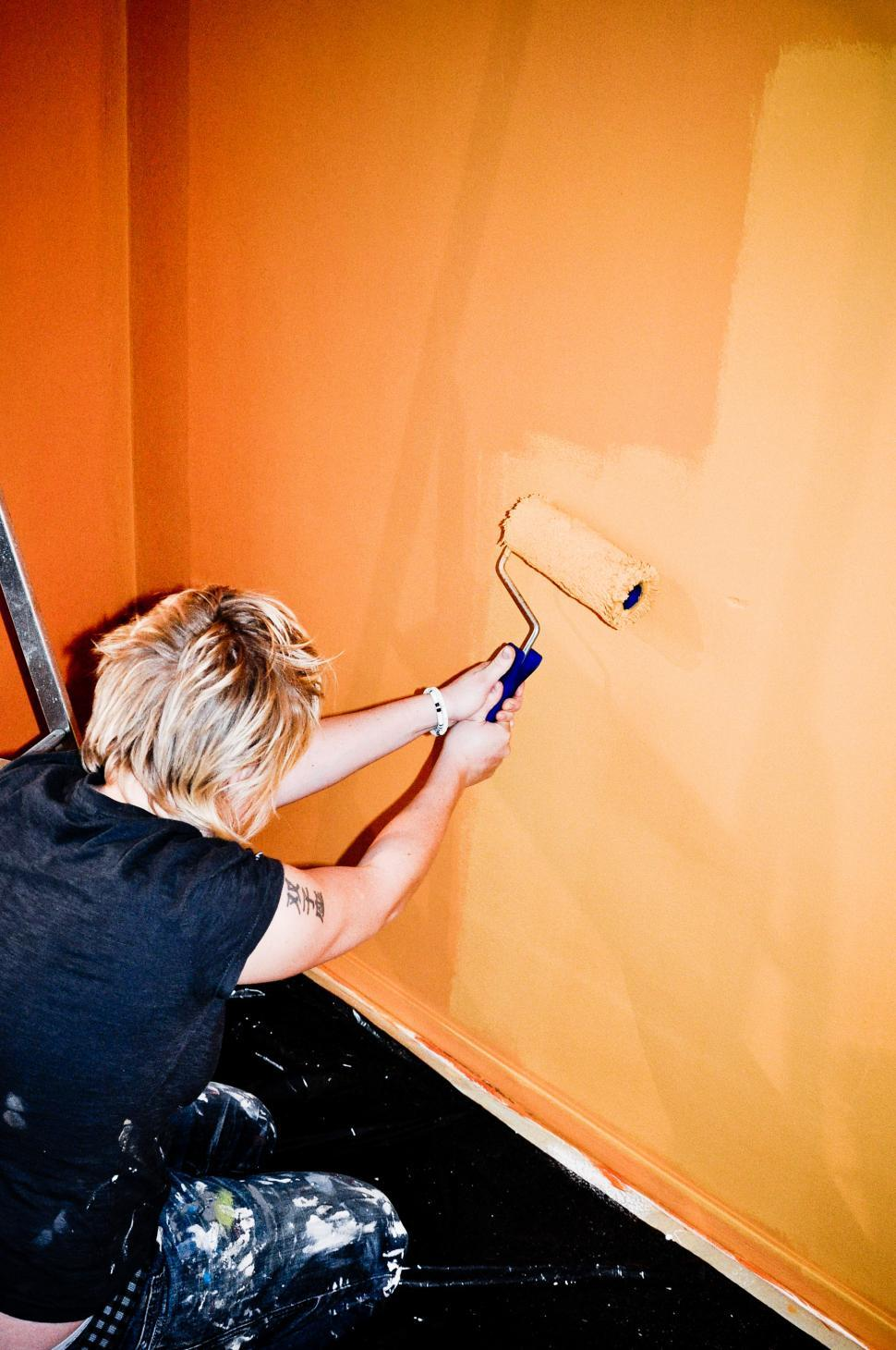 Download Free Stock HD Photo of Girl painting wall Online
