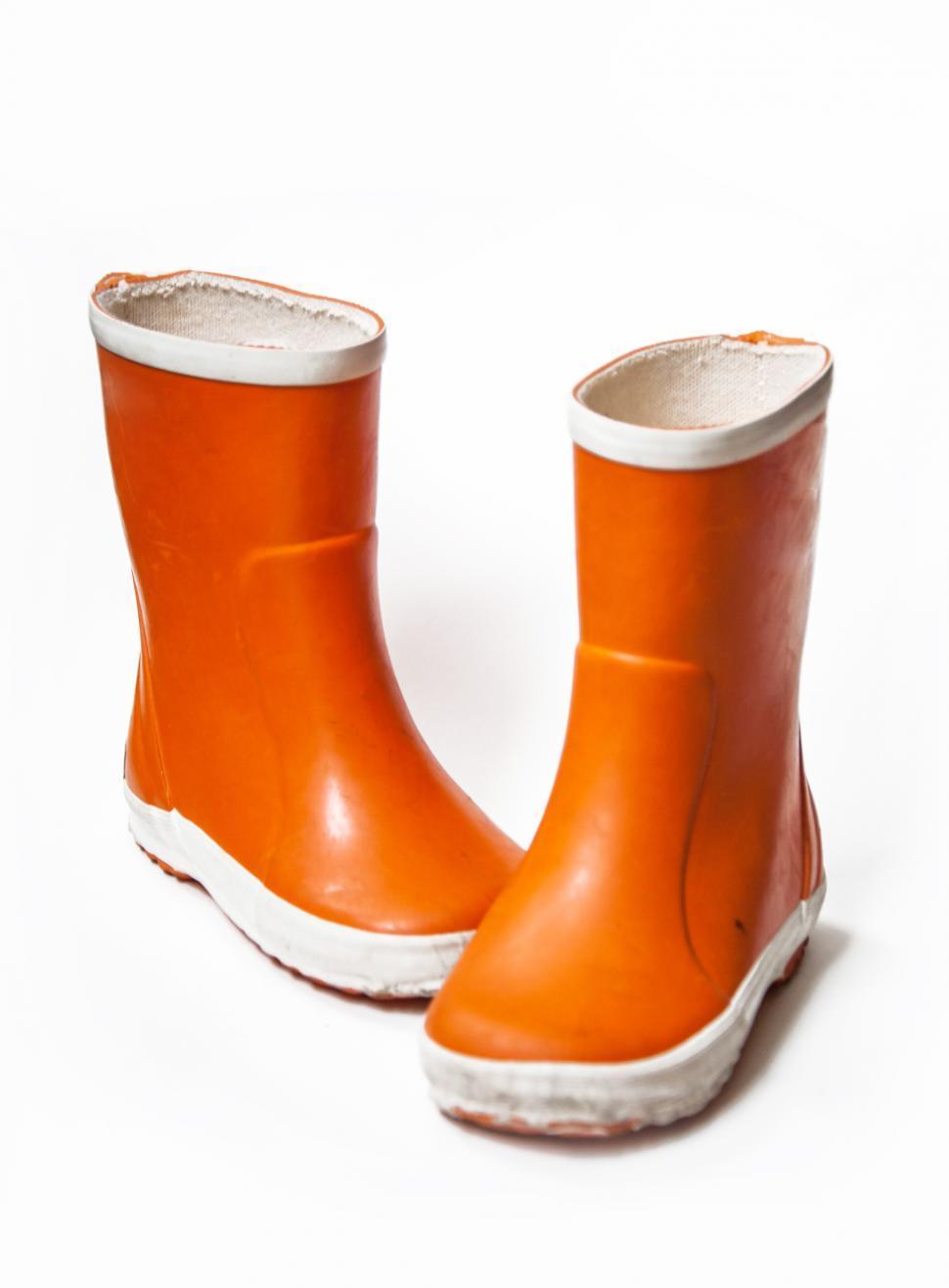 Download Free Stock HD Photo of Orange children`s rain boots Online