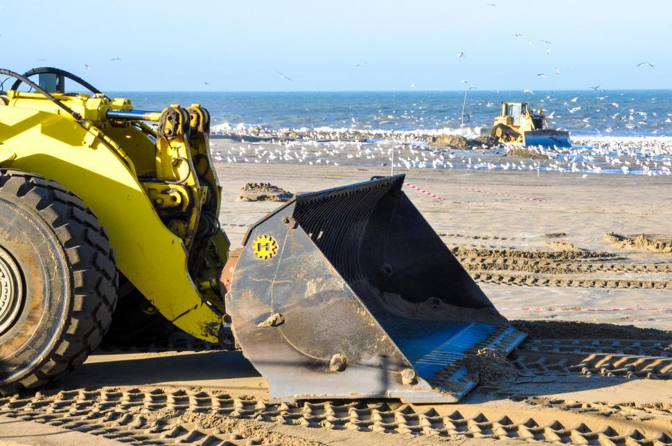 Download Free Stock HD Photo of bulldozer working on a beach Online
