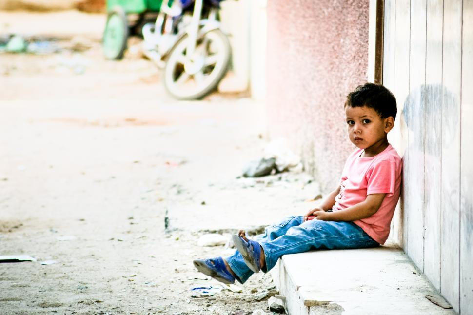 Download Free Stock HD Photo of Sad little boy waiting outside Online