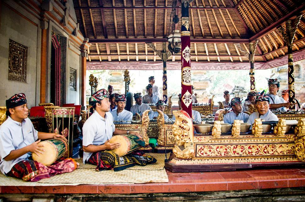 Download Free Stock HD Photo of Men play traditional gamelan percussion  Online