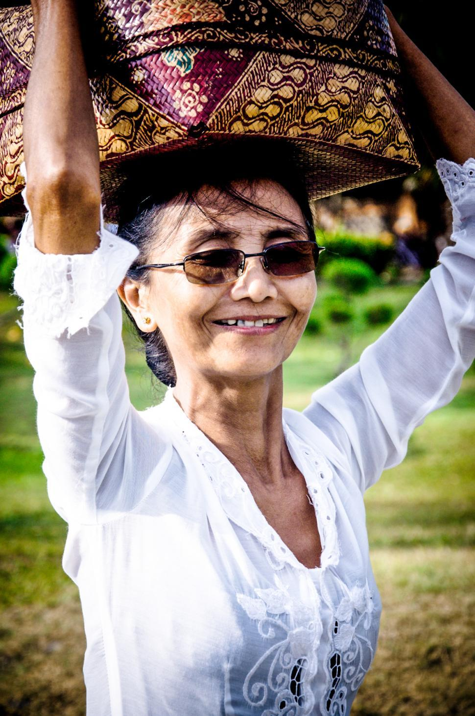 Download Free Stock HD Photo of Portrait of a balinese woman with a basket Online