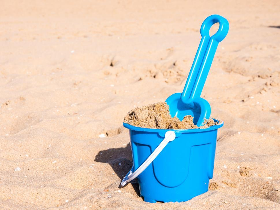 Download Free Stock HD Photo of A view of a basket and scoop at the beach Online