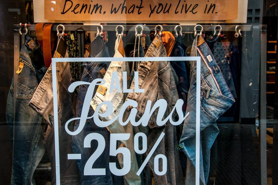 Download Free Stock HD Photo of Sale sign on the clothes shop window. Online
