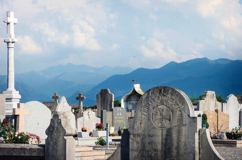 Download Free Stock HD Photo of Graveyard and mountains Online