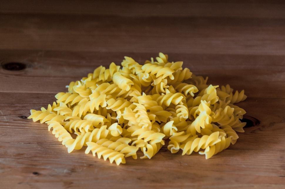 Download Free Stock HD Photo of Fusilli pasta on a old wooden background Online
