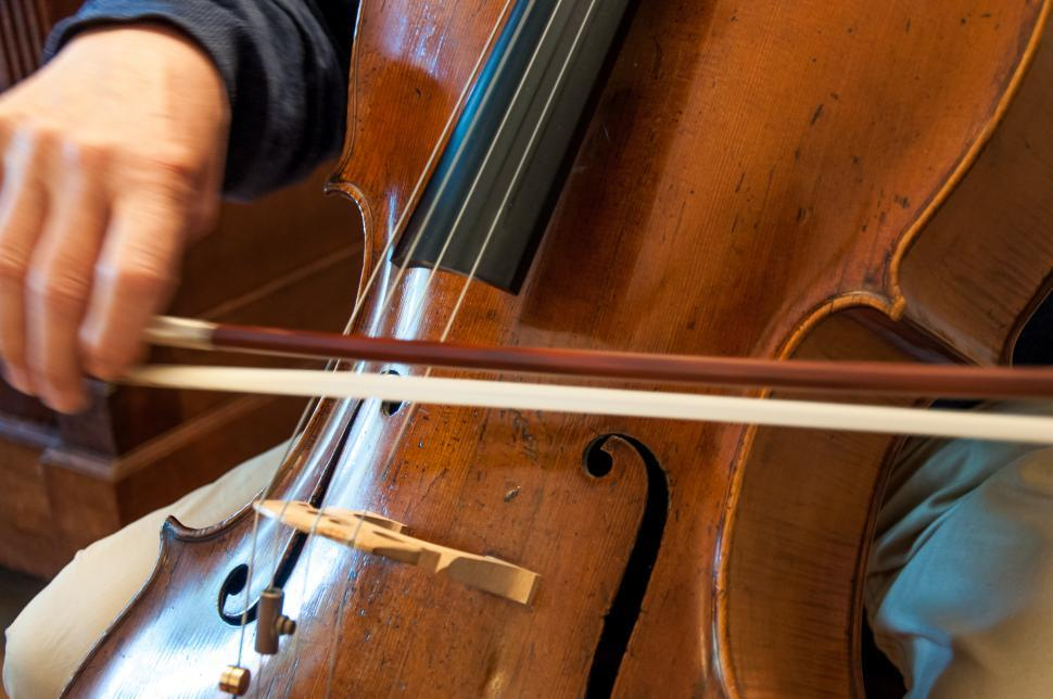 Download Free Stock HD Photo of Cello professional player with symphony orchestra Online