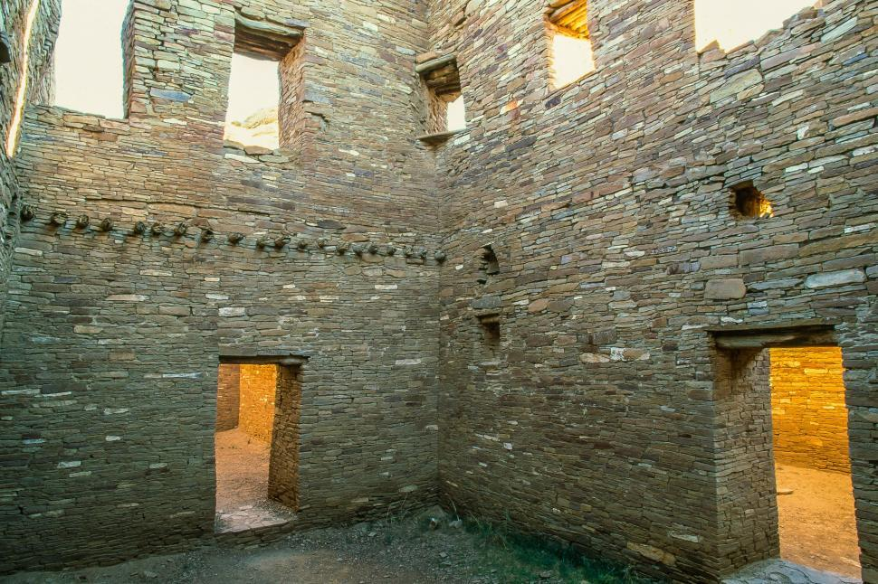Free image of Two story space/beams/dorways and light patters of Pueblo Bonito, New Mexico
