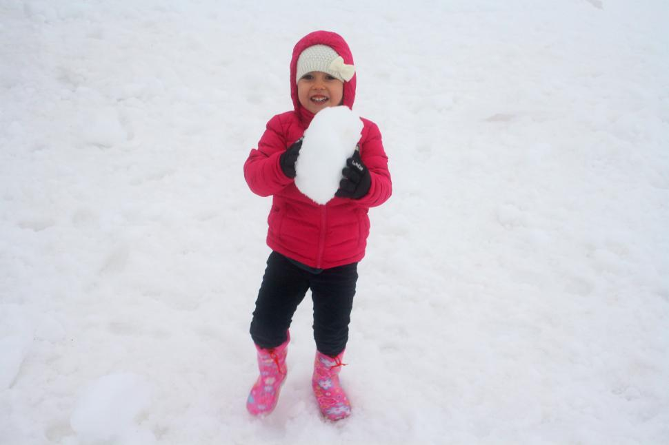 Download Free Stock HD Photo of Child playing on the snow Online