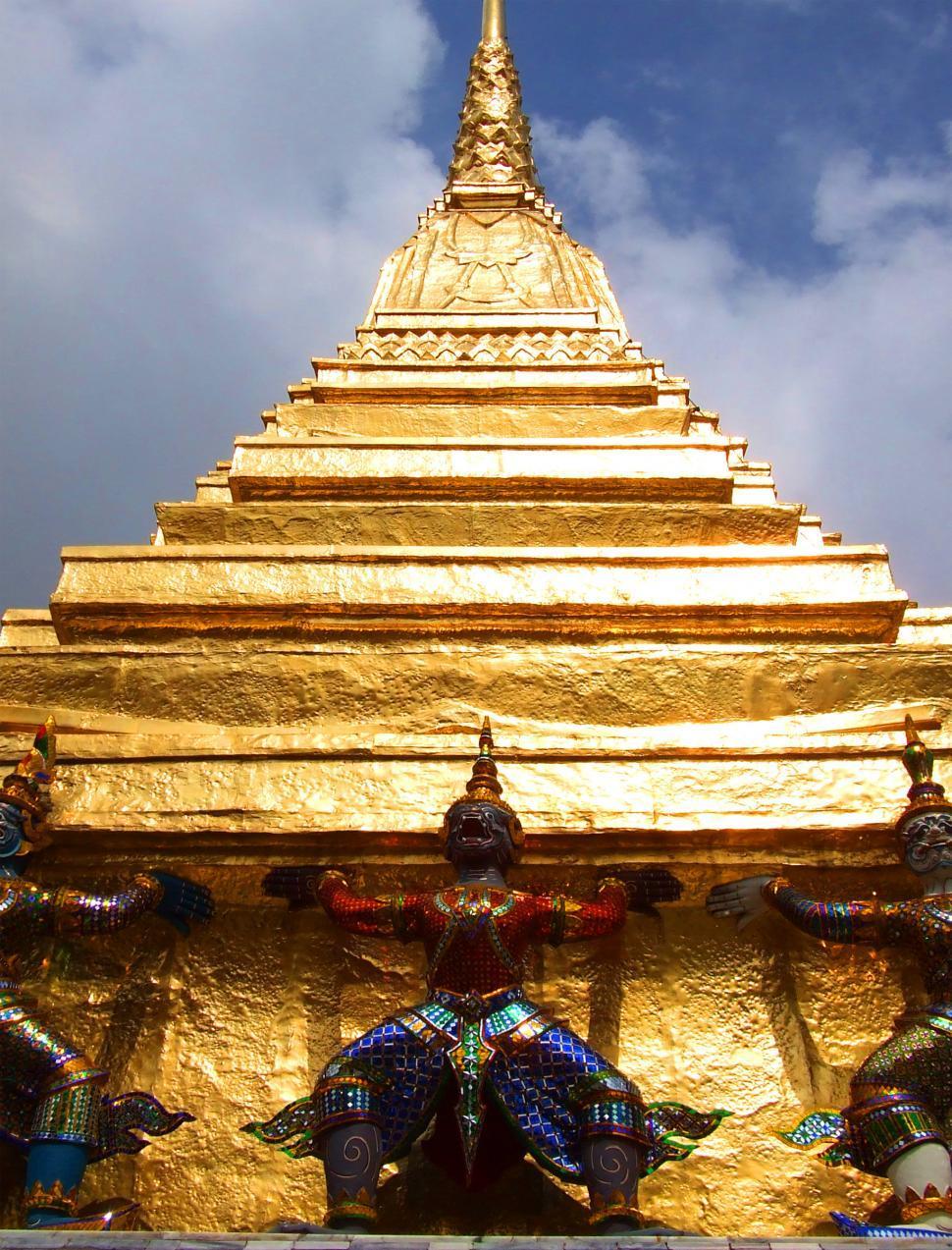 Download Free Stock HD Photo of Guardians lifting the Pagoda - Wat Phra Kaew - Bangkok - Thailan Online