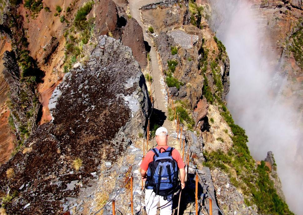 Download Free Stock HD Photo of Hiker on the mountain ridge - Madeira Island - Portugal Online