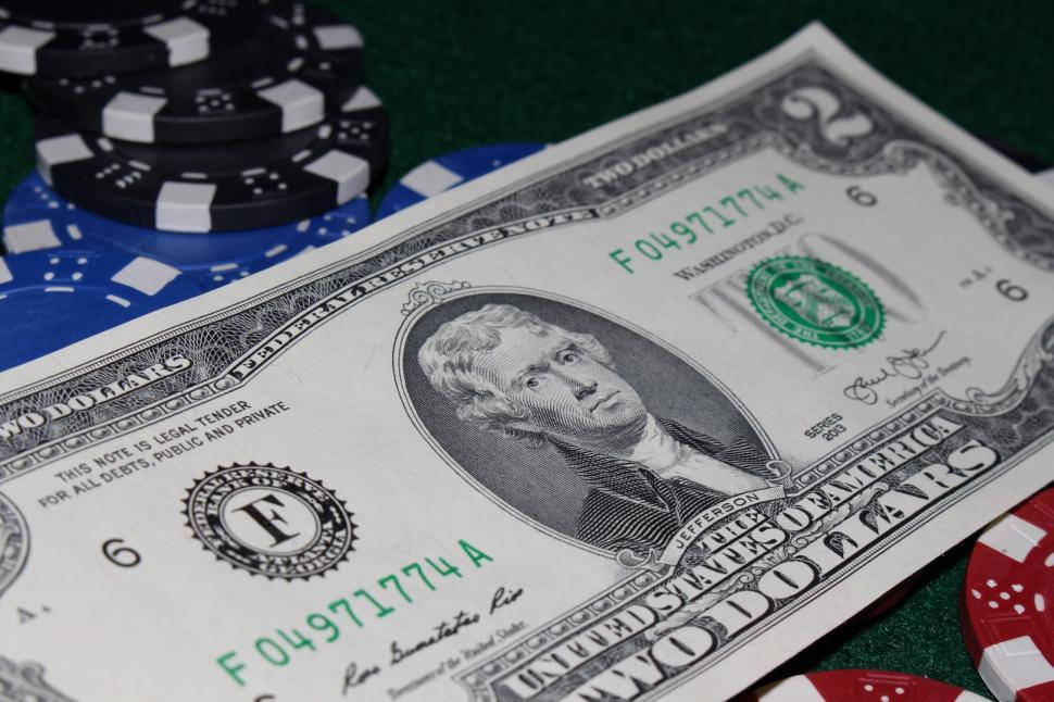Download Free Stock HD Photo of 2 dollar bill and poker chips Online