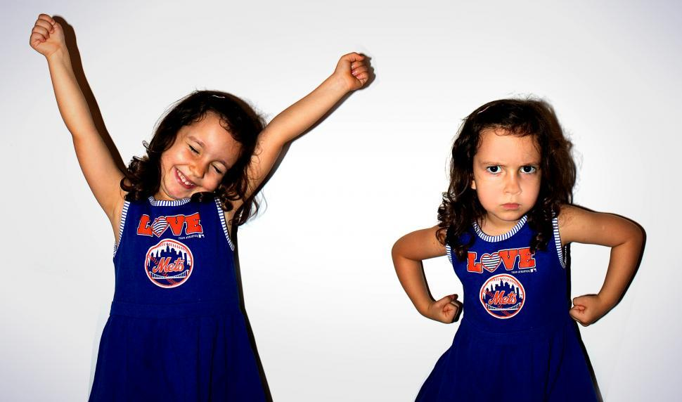 Download Free Stock HD Photo of Twin girls with opposite emotions Online